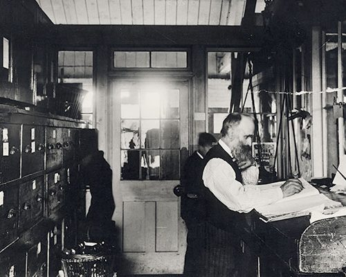 Staff working in silk mill office