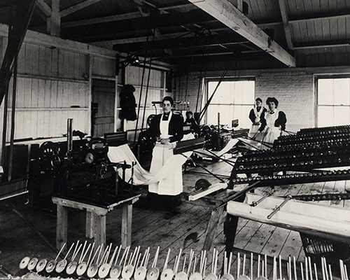 Silk mill staff at work, warping.