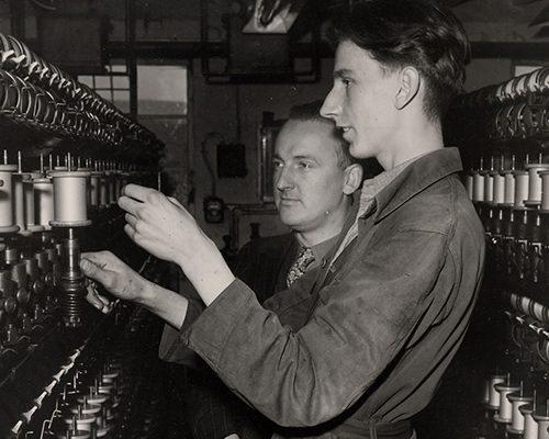 Two men working in silk mill